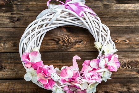hung: Easter wreath with easter eggs and flowers, spring decoration