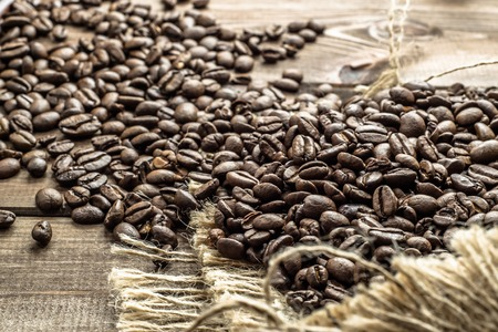 sacco juta: Roasted coffee beans in a jute sack, cafe concept