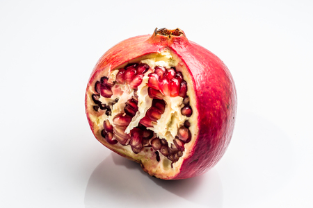 Cut pomegranate isolated on a white background