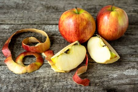 quarters: Whole apples and two quarters apples on rustic table