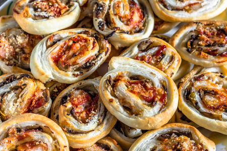 mini oven: Background with french pastry rolls baked in oven, close-up