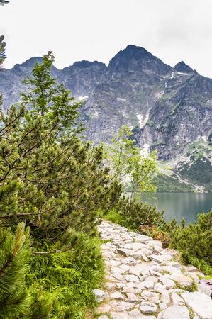 oko: Landscape of mountain trail, Morskie Oko lake near Zakopane, Tatra Mountains, Poland Stock Photo