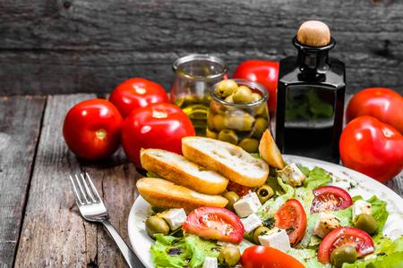 Plate of salad, greek food, mediterranean diet with vegetables and feta Foto de archivo