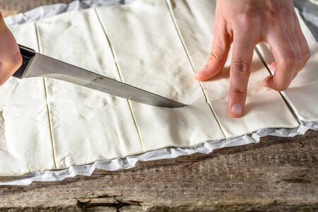 pasteleria francesa: Hand cutting dough for a french pastry snacks, baking concept