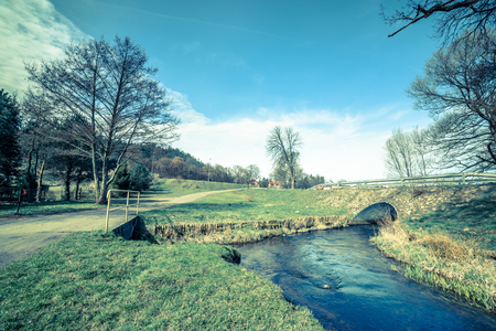 Stone bridge over river, early spring landscape Stock Photo