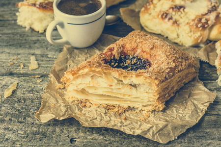 pasteleria francesa: Unhealthy breakfast - french pastry, sweet bun and coffee cup on wooden table