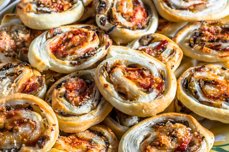 mini oven: Background with baked french pastry rolls, close-up Stock Photo