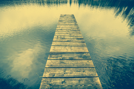 Wooden pier over lake, landscape, moody sky