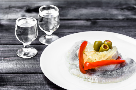 Marinated herring and vodka shot Stock Photo