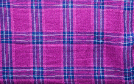 Textile texture of the checkered shirt useful as background