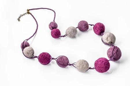 Felt necklace. Handmade stylish felt jewelry made with colorful felt beads isolated on a white background Stok Fotoğraf - 73300097