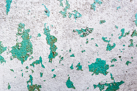 Old flaking paint on concrete background, wall texture