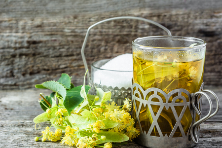 Herbal tea with linden flowers, concept of treatment cold and flu Stock Photo