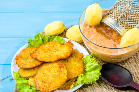 Fried potato pancakes, homemade cooking recipe, vegan food concept