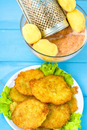 jewish home: Fresh fried potato pancakes, homemade cooking concept, vegan cuisine recipe, top view