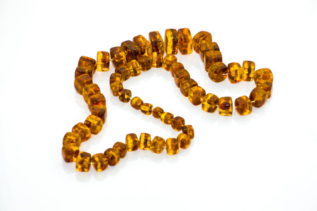 Amber necklace isolated on a white background