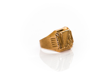 Gold ring on white background