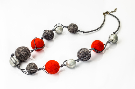Felt necklace. Handmade stylish felt jewelry made with colorful felt beads isolated on a white background