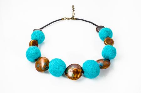 Felt necklace. Handmade stylish felt jewelry made with colorful felt beads isolated on a white background Stok Fotoğraf - 74649455