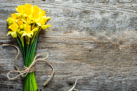 Spring background, easter daffodils, bouquet on wooden table