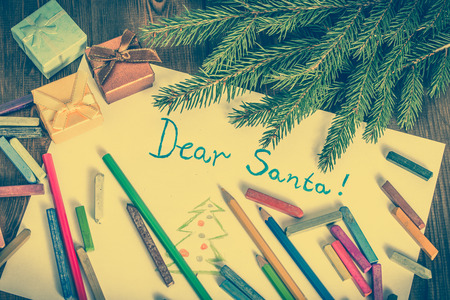 Christmas letter to Santa Claus. White paper to writing and gift boxes.