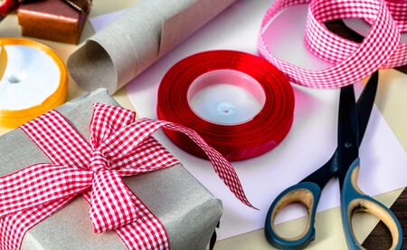 Christmas gift box in rustic package, present wrapped in paper and ribbon Stok Fotoğraf