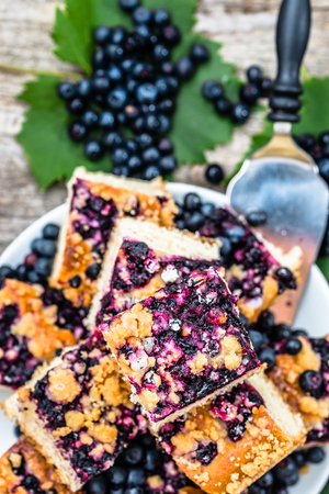 Sweet tart with bilberry fruits, yeast pie, summer baking concept, view from above