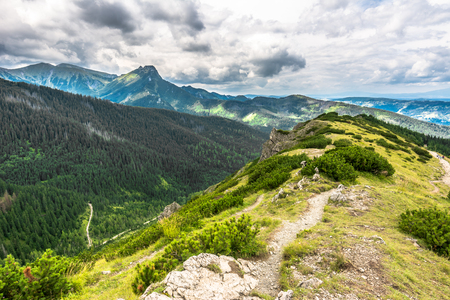 Spring mountain landscape, view of hiking trail on hillside of the ridge of Tatra Mountains Stock Photo