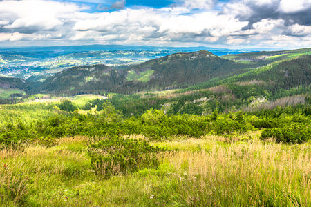 Panorama of city in mountains, spring landscape with blue sky and pine forest Stock Photo