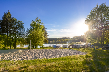 Caravans and camping on the lake. Family vacation outdoors, travel concept Reklamní fotografie