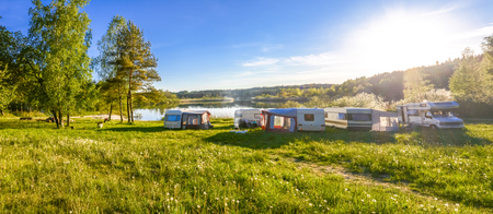 Caravans and camping on the lake. Family vacation outdoors, travel concept Banco de Imagens