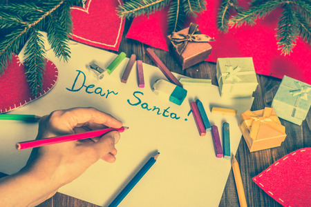 Hand writing letter to Santa Claus. Christmas card with decorations. Zdjęcie Seryjne - 82974794