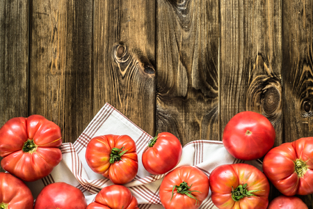 Homegrown tomatoes, organic vegetables on wooden background, copy space, top view