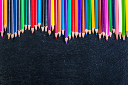 Colorful pencils frame background on black, copy space Stock Photo
