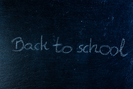Back to school text on black chalkboard