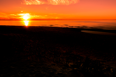 Silhouette of sunset beach, landscape with sun on the sky going to the sea, summer background Stock Photo