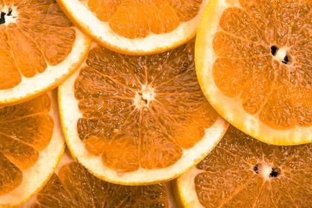 オレンジ果実の質感、自然な背景をスライス 写真素材
