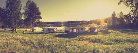 Caravans and camping on the lake. Family vacation outdoors, travel concept Stock Photo