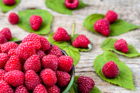 berry: Closeup raspberries in bowl on wooden table