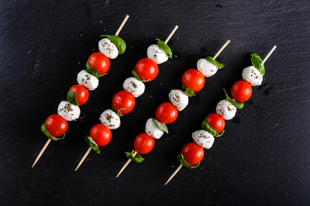 Italian food - caprese salad - skewer with tomato, mozzarella and basil, mediterranean diet concept
