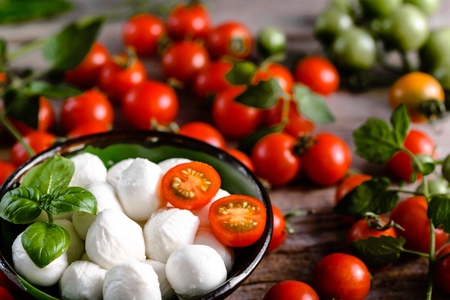 Basil, tomatoes and mozzarella for caprese salad, italian food and mediterranean diet concept