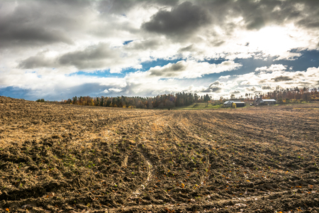 Farm houses in the countryside and plowed field in autumn, landscape Stock fotó