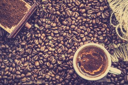 Black coffee cup called espresso, italian hot drink with foam, overhead Banco de Imagens - 84974020