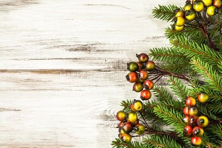 Green spruce branch, christmas backgrounds on white table
