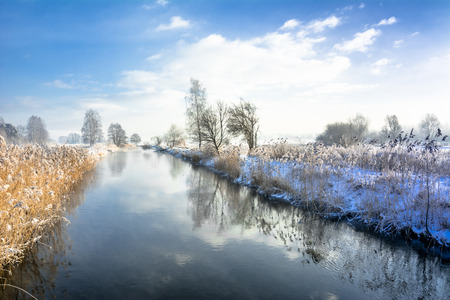 Landscape of river in spring thaws and blue sky Zdjęcie Seryjne