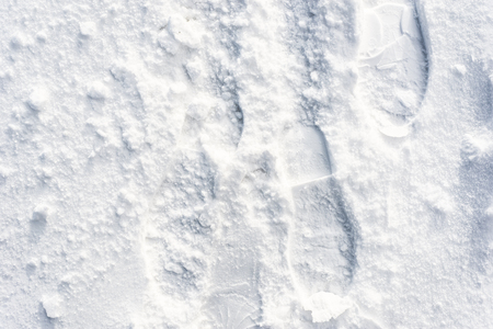 Footprints in snow, winter texture for design background
