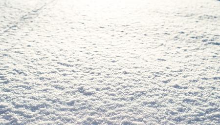 雪の冬の質感、光沢のある雪、背景