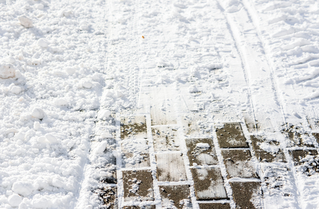 Background of snow on footpath in winter, texture of pavement Banco de Imagens