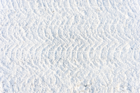 Road in winter, texture of snow and and traces of the tread Stock Photo