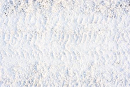 冬の道路、雪の質感、トレッドの痕跡